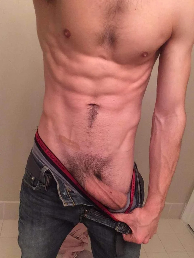 Ripped boy shows his big dick